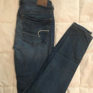 """super stretch"" low rise jeans."